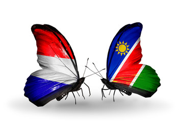 Two butterflies with flags Holland and Namibia