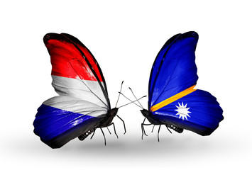 Two butterflies with flags Holland and Nauru
