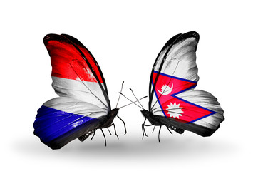 Two butterflies with flags Holland and Nepal
