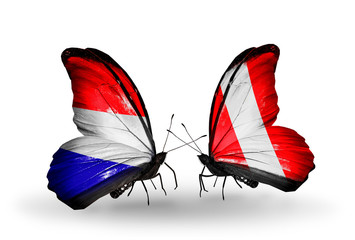 Two butterflies with flags Holland and Peru