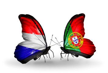 Two butterflies with flags Holland and Portugal