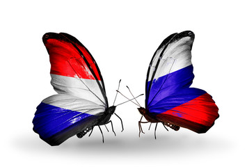 Two butterflies with flags Holland and Russia