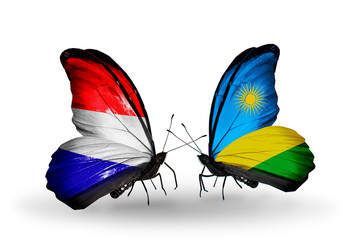 Two butterflies with flags Holland and Rwanda