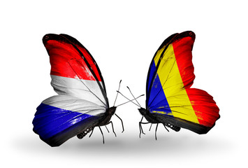 Two butterflies with flags Holland and Chad, Romania