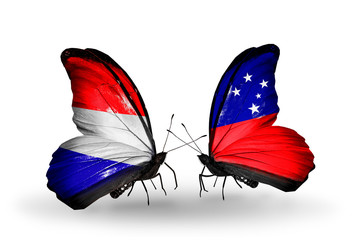 Two butterflies with flags Holland and Samoa