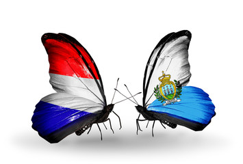 Two butterflies with flags Holland and San Marino