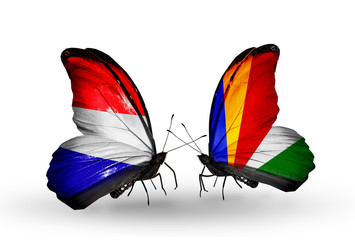 Two butterflies with flags Holland and Seychelles