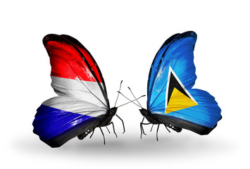 Two butterflies with flags Holland and Saint Lucia