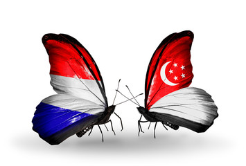 Two butterflies with flags Holland and Singapore
