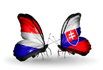 Two butterflies with flags Holland and Slovakia