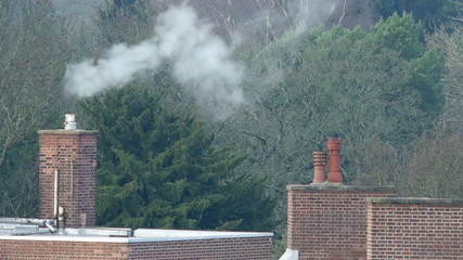 Steam rising from a chimney pot.
