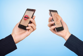 Phone cell concept. Man's hand holding phone with speaking woman