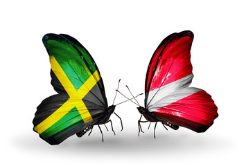 Two butterflies with flags Jamaica and Latvia