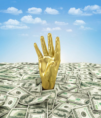Gold hand makes its way through a bunch of dollars.