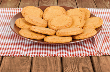 ginger biscuits in a bowl on a wooden background