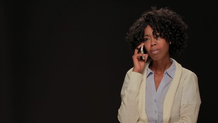 Young African American black woman talking on cellphone