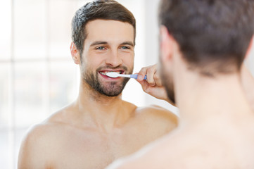 Brushing teeth in the morning.