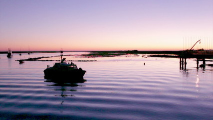 Sunset in Quatro-Aguas boat pier. Algarve