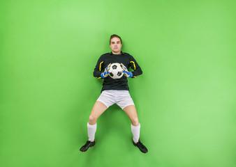 Goalkeeper catching a ball