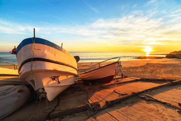 Boats in warm sunset light on the Fisherman's Beach in Albufeira