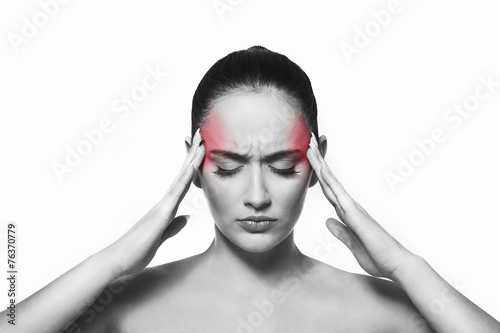 Woman suffering from the head ache - 76370779