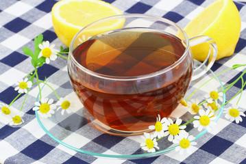 Tea with chamomile flowers and lemon