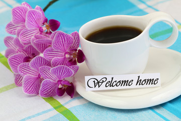 Welcome home card with cup of coffee and pink orchid
