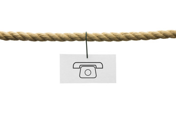 White card with phone symbol hanging by wire from a rope isolate