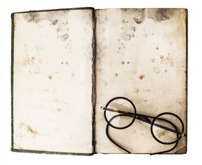 Old books with eye glasses
