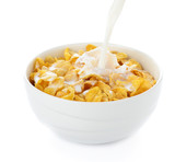 pouring milk into cornflakes bowl isolated on white - 76371796