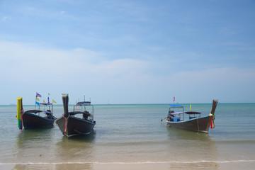Three wooden boats