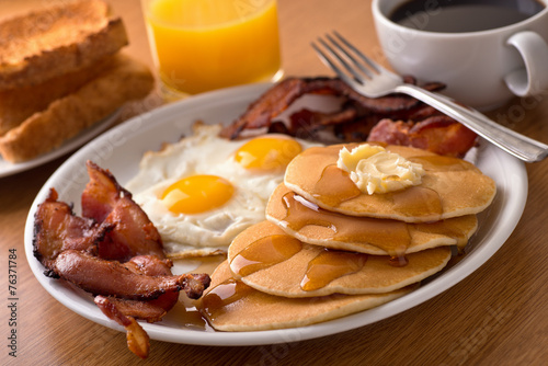 Breakfast with bacon, eggs, pancakes, and toast poster