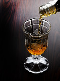 Pouring whiskey into cup before meal - 76371948