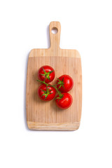 Top view of fresh tomatoes on chopping board