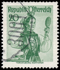 Stamp printed in Austria, shows a woman from Vorarlberg, Montafo