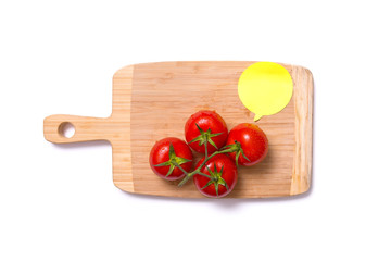 Top view of fresh tomatoes on chopping board with speech bubble