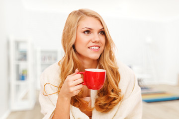 Young woman relaxing with a cup of coffee