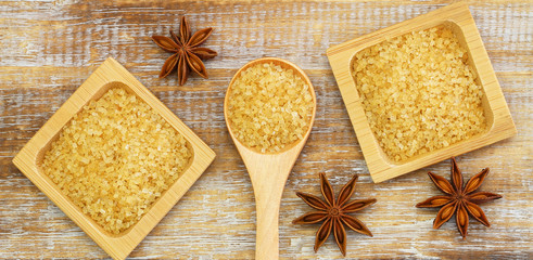 Brown sugar and star anise on rustic wooden surface
