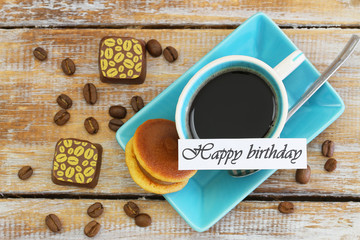 Happy Birthday card with cup of coffee, cookie and chocolates