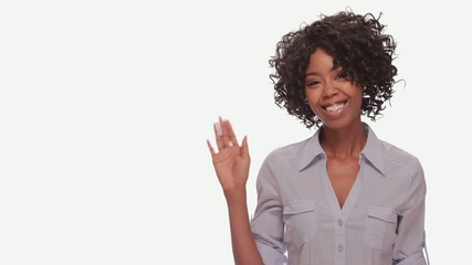 Young African American black woman wave hand smiling