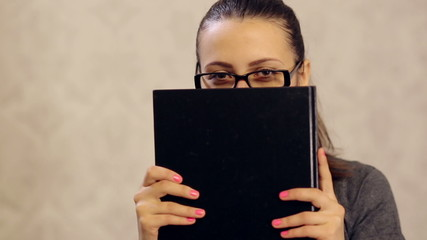 Woman Hiding Behind the Book