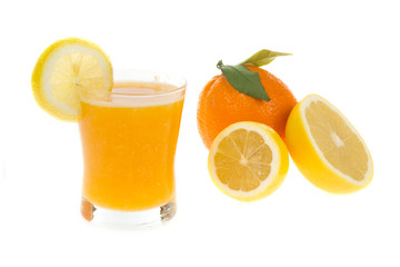 Juice in glass with citrus fresh fruit