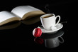 hot drink black espresso coffee with a book and macaroon