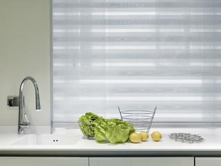 vegeatlbes and lemons on the worktop in a modern kitchen