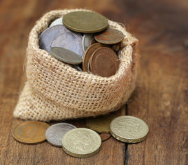 Old coins in sack bag