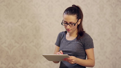 Woman in Glasses Working at Tablet PC