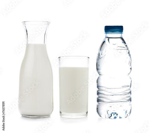 Leinwandbild Motiv drinking water and milk on white background