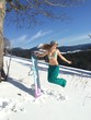 jumping girl with snowboard