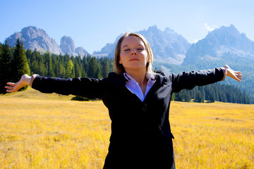 Happy businesswoman feeling the freedom from work