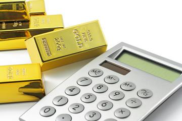 goldbarren mit taschenrechner